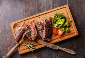 Steamed broccoli with strip steak